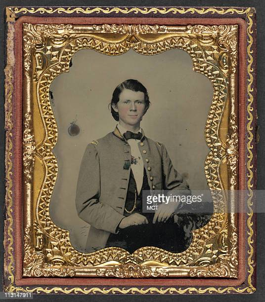 """An Unidentified soldier in Confederate frock coat with gold trim is found in the exhibition, """"The Last Full Measure: Civil War Photographs from the..."""