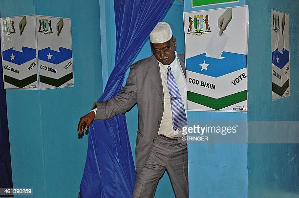 An unidentified Somali MP exits a voting booth in Garowe in Somalia's semiautonomous Puntland region on January 8 2014 Deputies in Somalia's...