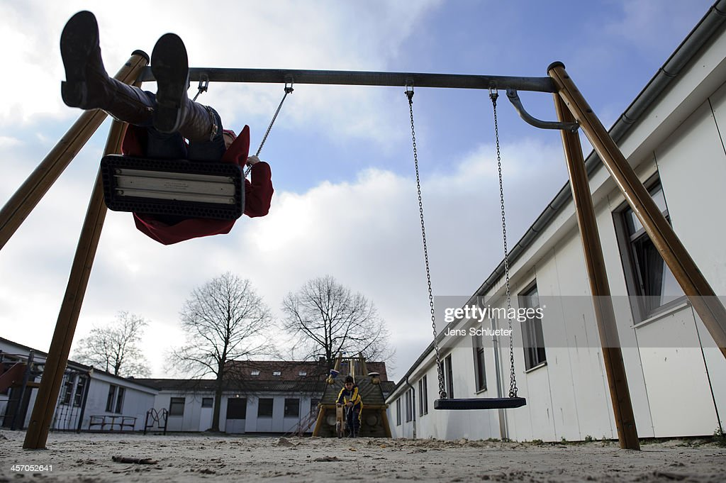 An unidentified Syrian refugee plays on a swing in the playground at the refugee center on December 10, 2013 in Friedland, Germany. Hundreds of thousands of Syrians have fled Syria to neighboring countries as well as to Europe. Germany is accepting up to 5,000 Syrian refugees, though German church leaders recently called on their country to take at least 10,000.