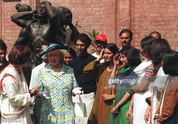 An unidentified teacher of Lahore National College of Arts briefs visiting Britain Queen Elizabeth II during her visit 10 October. The Queen visited...