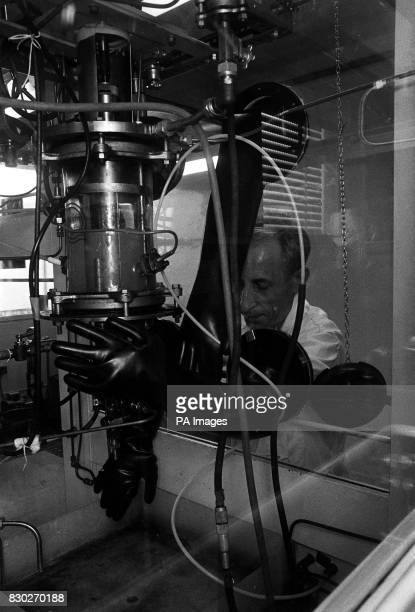 An unidentified technician employed in the Experimental Establishment at Porton Whiltshire is shown during today's open day using stirred culture...