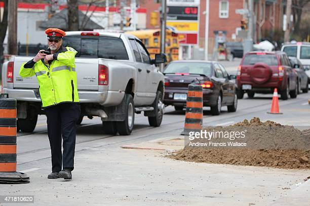 An unidentified Toronto Police officer works paid duty at the corner of Woodbine and Kingston Rd. April 30, 2015. Mayor John Tory talks about...