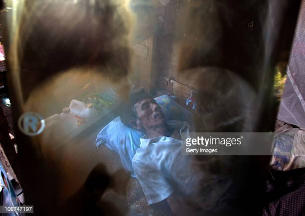 An unidentified tuberculosis patient sleeps on the floor of his home in the outskirts of Yangon on November 11 2010 in Yangon Burma Burma's top court...