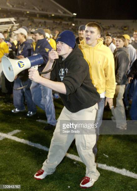 An unidentified University of West Virginia student taunts officials of the West Virginia State Police with a megaphone chanting Give us our goal...