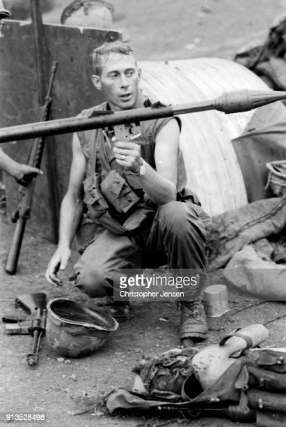 An unidentified US Army soldier holds up a rocketpropelled grenade launcher at a small US base Kham Duc Republic of Vietnam August 5 1970 The...