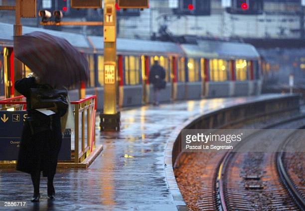 An unidentified user waits for a train at Saint Lazare railway station in central Paris as French rail workers stage a strike January 21 2004 in...