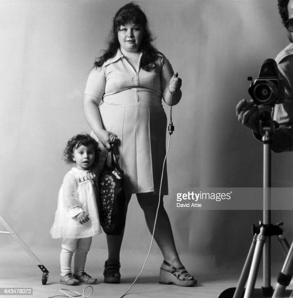 An Unidentified woman and her daughter are set up by photographer David Attie to take their own picture for Attie's book 'Russian SelfPortraits' in...
