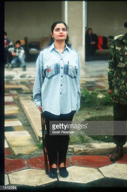An unidentified woman at AlHariri Secondary School undergoes military training February 10 1998 in Baghdad Iraq Tensions have increased between Iraq...
