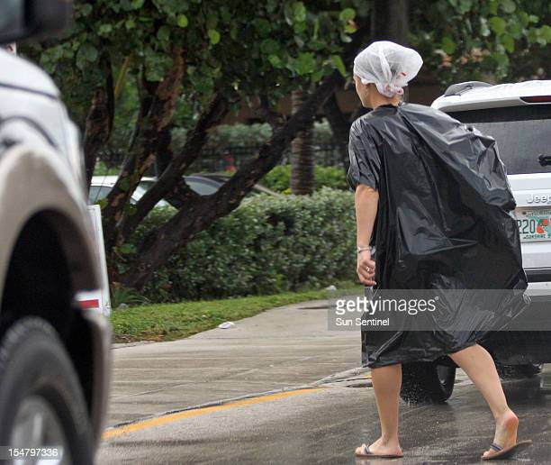 An unidentified woman dressed in bags crosses Seabreeze Blvd. On Ft. Lauderdale Beach, Florida, Friday, October 26 as Hurricane Sandy passes to the...