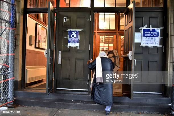 An unidentified woman enters a polling place for midterm elections at PS 69 November 6 2018 in the Jackson Heights neighborhood of the Queens borough...