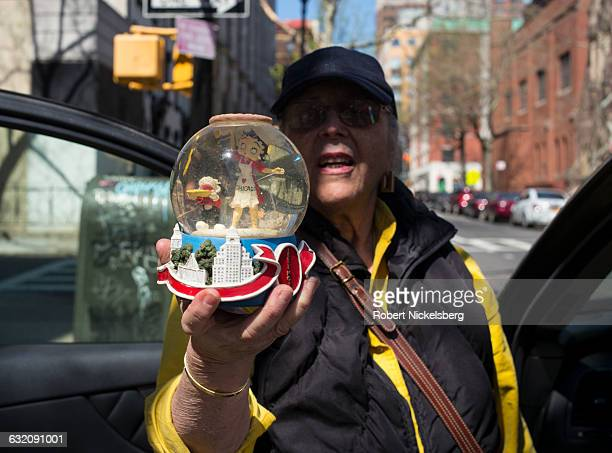 An unidentified woman holds up a snow globe she purchased at a stoop sale with a miniature character of Betty Boop inside in Brooklyn NY NY April 17...