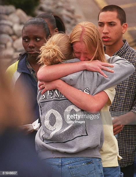 An unidentified woman hugs a student as they and others grieve after the Columbine High School massacre Littleton Colorado April 21 1999
