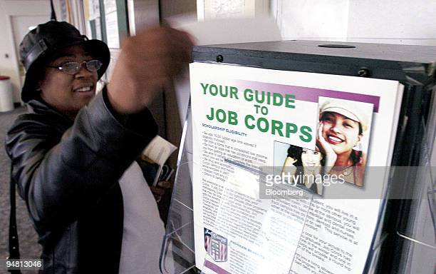 An unidentified woman looks through flyers at the staterun Employment Development Career Center in Oakland California on Friday May 6 2005 US...
