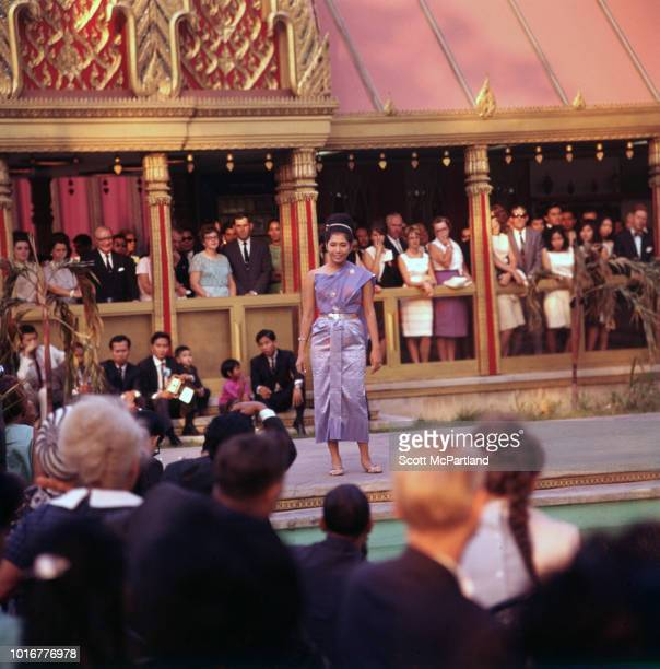 An unidentified woman performs for a crowd of spectators at the World's Fair in Flushing Meadows Park Queens New York New York June 1965