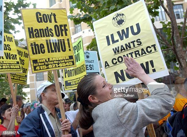 An unidentified woman pounds a sign during an International Longshore and Warehouse Union rally on August 12 2002 in Oakland California Negotiations...