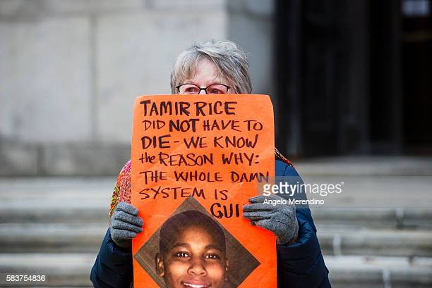An unidentified woman protests the death of 12year old Tamir Rice in Cleveland Ohio on November 26 Rice was shot by a Cleveland Police Officer...
