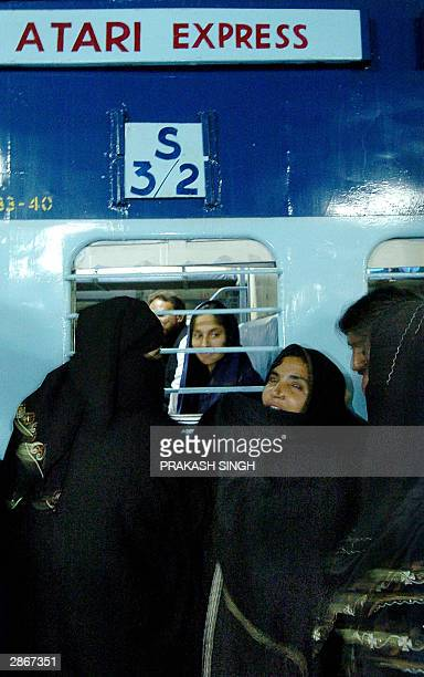An unidentified woman says her farewells to her relatives as the Atari Express train departs from Old Delhi Railway Station 14 January 2004 The Atari...