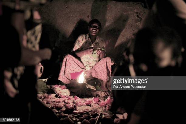 An unidentified woman sells fish at a night market on March 16 2006 in Lukutu Congo DRC Lukutu located along the Congo River is a small village with...