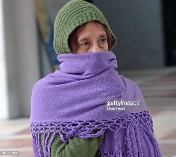 An unidentified woman shivers in downtown Miami on a brisk morning Tuesday Jan 7 2014