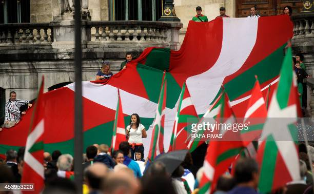An unidentified woman sings during a pro independence protest in favour of the Basque flag and against the Spanish flag as part of the local...