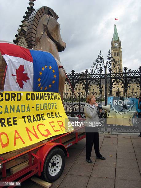 An unidentified woman speaks on October 17 2011 in front of the Canadian parliament in Ottawa Ontario after Canadian and European civil society...