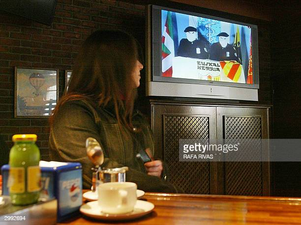 An unidentified woman watches a TV set at a bar in Vitoria northern Spain while the regional Basque Television broadcastes the pro independence armed...