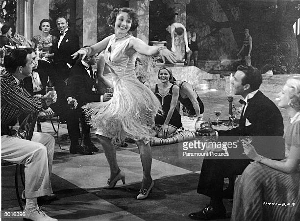 An unidentified woman wearing a 'flapper' style skirt dances at a party in a still from the film 'The Great Gatsby' directed by Elliott Nugent 1949