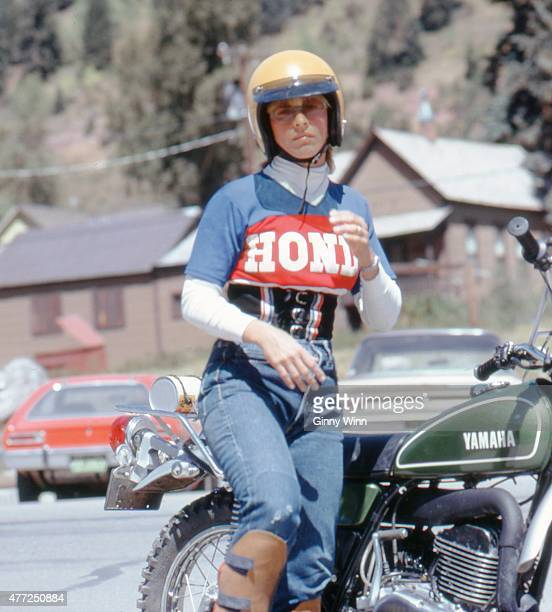 An unidentified woman wearing a Honda shirt and riding a Yamaha motorcycle poses for a photo during the first annual Telluride Film Festival in 1974...