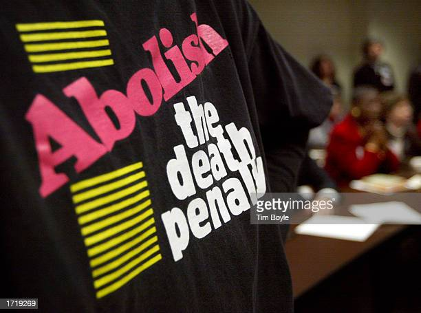 An unidentified woman wears a tshirt which reads Abolish the death penalty as she attends a speech by Illinois Governor George Ryan at DePaul...