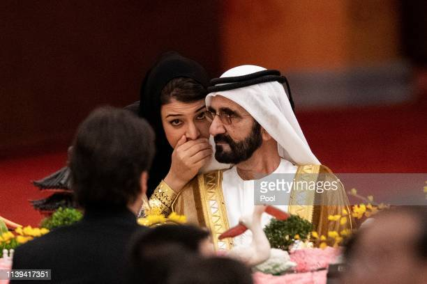 An unidentified woman wispers to UAE Vice President and Prime Minister Mohammed bin Rashid Al-Maktoum during the welcome banquet for leaders...