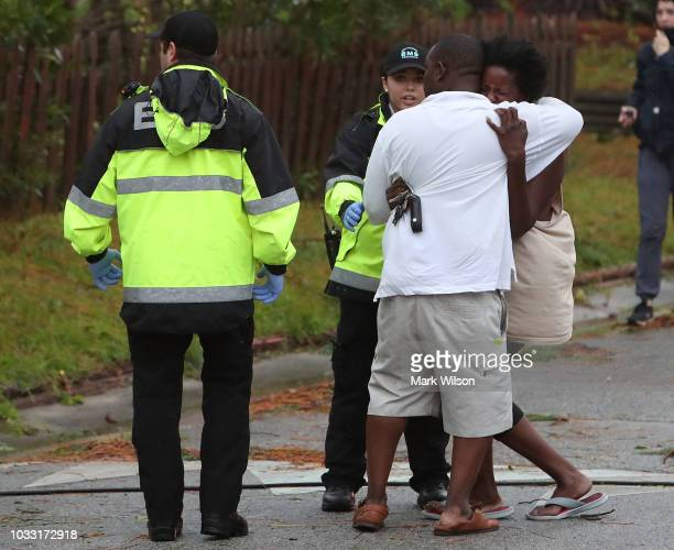 An unidentified women reacts to news of a home that a large tree fell on with three trapped after Hurricane Florence hit the area on September 14...