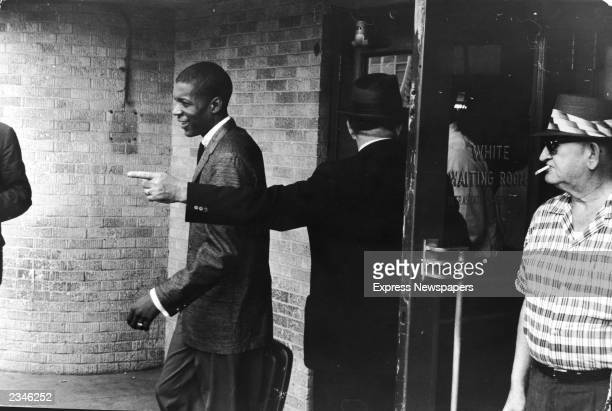 An unidentified young Black 'Freedom Rider' is told to leave a segregated 'white' waiting room at a bus depot in Jackson Mississippi May 26 1961 The...