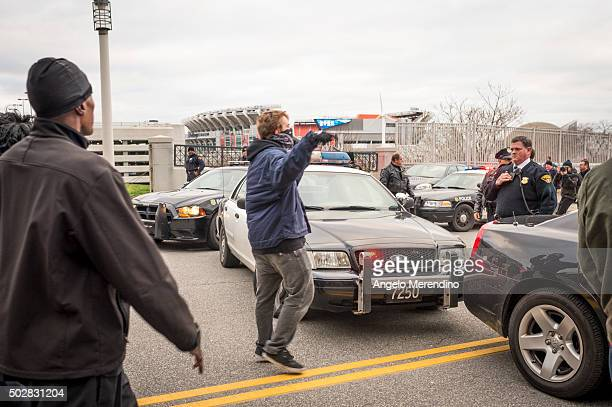 An unidentified young male confronts a police officer on E9th St on December 29 2015 in Cleveland Ohio Protestors took to the street the day after a...