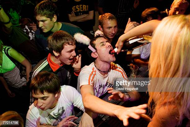 An unidentified young man drinking from a bottle held by an event girl September 15 2006 in the night club Hollywood in Tallinn Estonia Estonia...