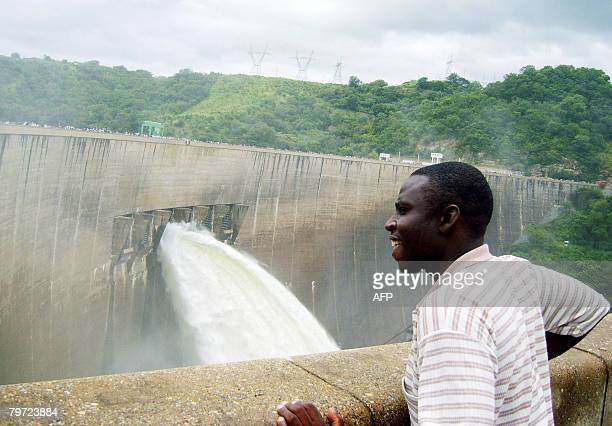 An unidentified Zambian witnesses the opening of the Spill gates on February 12 2008 at Kariba Dam in Zambia The Kariba Dam has been opened by...
