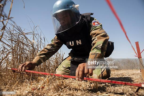 An UNIFIL's Cambodian mine expert demonstrates demining methods on August 26 2015 in the UNcontrolled buffer zone near the village of Mammari west of...