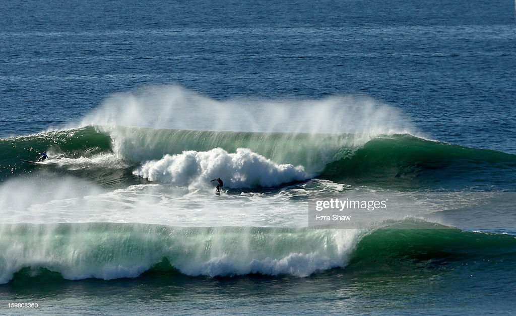 An unindentfied surfer competes in the semi-finals during the Mavericks Invitational surf competition on January 20, 2013 in Half Moon Bay, California.
