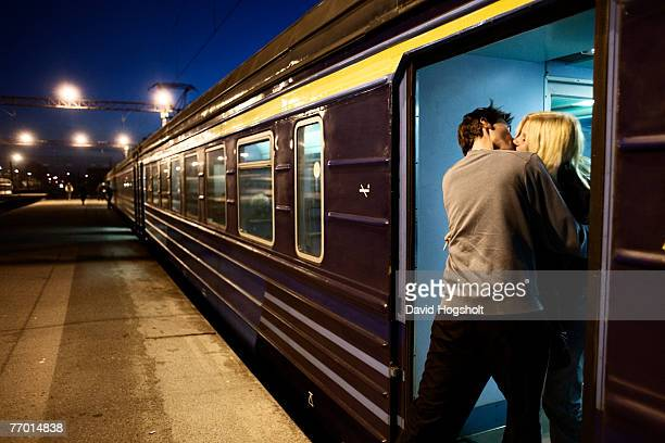 An unindentified couple kissing on a train in Tallinn's train station September 17 2006 in Tallinn Estonia Estonia gained independence from Russia in...