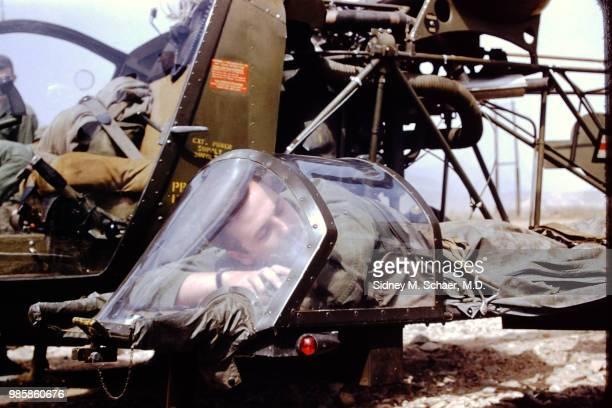 An uninjured US soldier lies on the stretcher platform of a evacuation helicopter at the 8063rd MASH South Korea January 1952