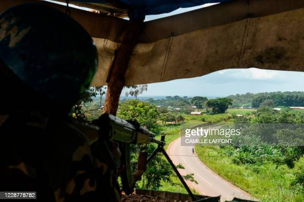 An United Nations Bangladeshi soldier part of MINUSCA guarding the RN1 road in Baboua, Central African Republic, on September 22, 2020. - The 3R...