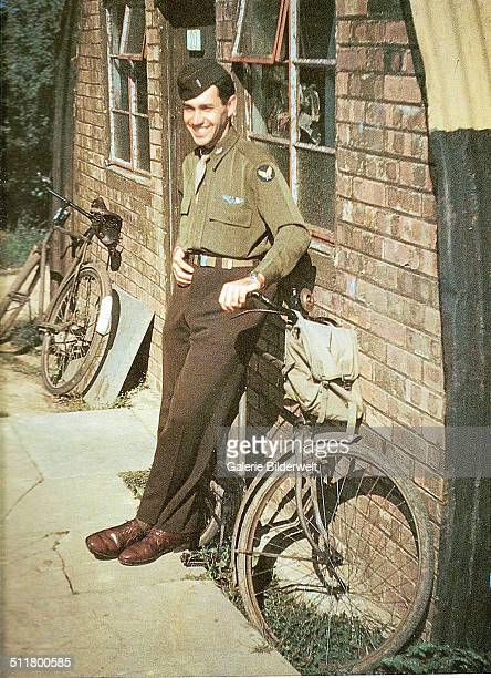 An United States Air Force pilot is standing in front of his quarters. 1944. He will be part of the invasion force. England, United Kingdom.