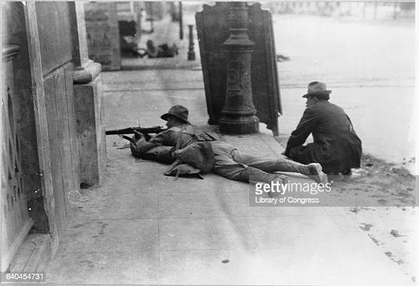 An United States Marine shoots his rifle with another man crouched behind him on the streets of Veracruz The United States invaded Veracruz in 1914...