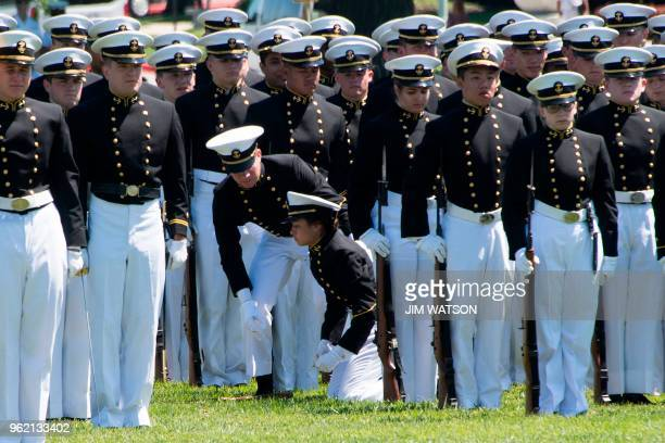 An United States Naval Academy midshipman passes out due to heat exhaustion during the Color Parade in Annapolis Maryland on May 24 ahead of the USNA...