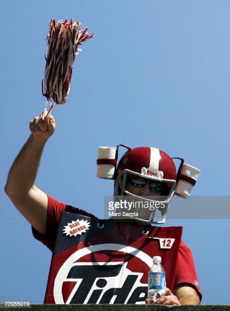 An University of Alabama Crimson Tide fan cheers as his team arrives to play the University of Florida Gators at Ben Hill Griffin Stadium at Florida...