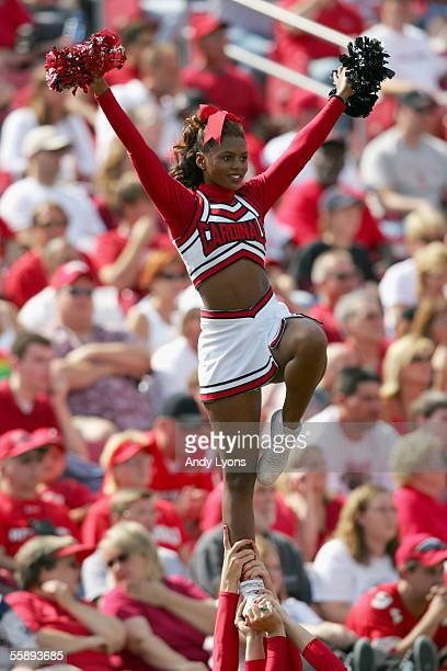 An University of Louisville Cardinals cheerleader performs during the game against the Florida Atlantic University Owls at Papa John's Stadium on...