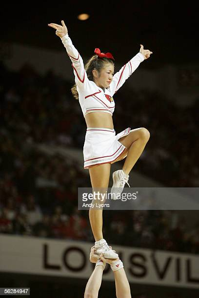An University of Louisville Cardinals cheerleader performs during the game against the University of Tennessee at Martin Skyhawks at Freedom Hall on...