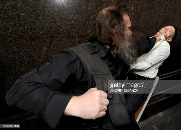 An unknown antigay activist hits a Russian gay and LGBT rights activist during unauthorized gay rights activists rally in cental Moscow on May 25...