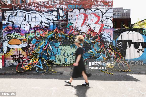 An unknown Artist Creates oBike mural in a lane way in Fitzroy on October 24 2017 in Melbourne Australia The yellow oBikes work on the premise of...