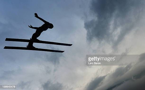An unknown athlet competes during the trial round for the FIS Ski Jumping World Cup event of the 61st Four Hills ski jumping tournament at...
