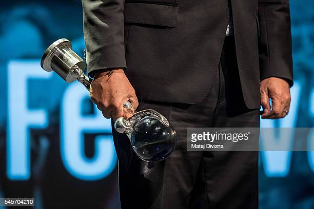 An unknown man holds the Crystal Globe Prize at the closing ceremony of the 51st Karlovy Vary International Film Festival on July 9, 2016 in Karlovy...